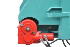 DE SERIE Entraînement du tapis par moto réducteur hydraulique à bain d'huile